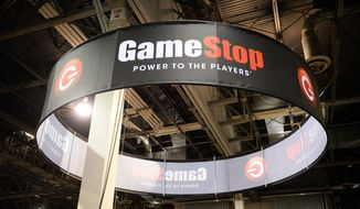 This Aug. 28, 2013, file photo shows signage at GameStop Vegas 2013, in Las Vegas. GameStop is diving into the video game publishing business. (Photo by Al Powers/Invision/AP, File)