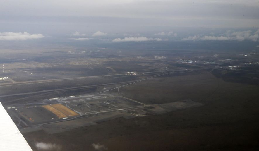 FILE - In this March 6, 2013 file photo, a portion of the Hanford Nuclear Reservation is seen from the air near Richland, Wash. A Department of Energy contractor is checking after more waste leaked from the inner tank of a double-shell waste storage tank at the reservation over the weekend of April 16, 2016.  (AP Photo/Ted S. Warren,File)