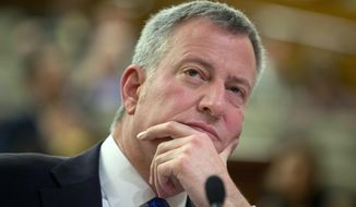 In this Jan. 26, 2016, file photo, New York City Mayor Bill de Blasio testifies during a joint legislative budget hearing on local government in Albany, N.Y. New York City's effort to monitor mentally ill people considered potentially violent has stirred unease among civil liberties and mental health advocates but de Blasio has said the program aims to protect public safety and provide treatment. (AP Photo/Mike Groll, File)