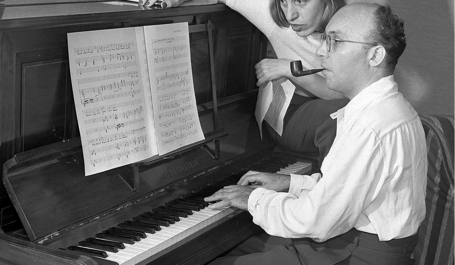 "FLE - In this Aug. 17, 1942 file photo, theatrical composer Kurt Weill and his wife, performer Lotte Lenya, are seen at the piano at their home in New City, in the Rockland County suburb of N.Y. Two young American singers have won a musical theater competition honoring Kurt Weill, who composed ""The Threepenny Opera."" The Lotte Lenya (LAH'-teh LEHN'-yuh) Competition on Monday, April 18, 2016, announced two top winners of the weekend contest in Rochester: Jim Schubin, of Plainsboro, N.J., and Brian Vu, of Los Angeles. (AP Photo/Robert Kradin, File)"