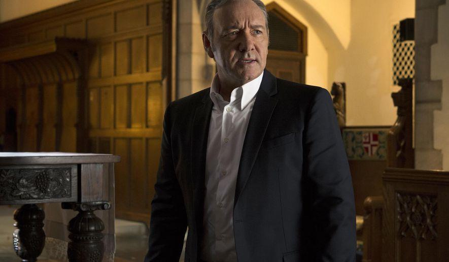 """FILE - In this file image provided by Netflix, Kevin Spacey appears in a scene from the Netflix original series, """"House of Cards."""" Netflix has been spending tons of money on new shows, and in sheer volume of new programming, it's already edged out HBO and other cable stalwarts. (David Giesbrecht/Netflix via AP, File)"""