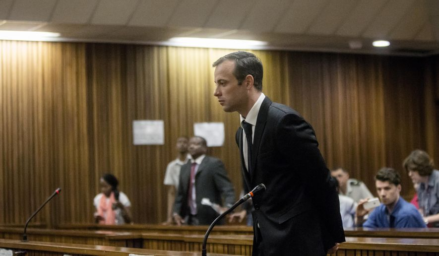 Oscar Pistorius bows to the court from the dock during a hearing at the High Court in Pretoria, South Africa on Monday, April 18, 2016. (Marco Longari/Pool Photo via AP) ** FILE **