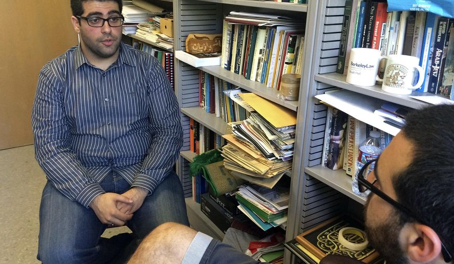 Khairuldeen Makhzoomi talks during an interview in his office in Berkeley, Calif., Monday, April 18, 2016. A University of California, Berkeley student who came to the U.S. as an Iraqi refugee says he was unfairly removed from a flight at Los Angeles International Airport earlier this month because a fellow passenger was alarmed by an innocent conversation he was having in Arabic. Southwest Airlines said in a statement Sunday that the passenger, Makhzoomi, was taken off the April 9, 2016, flight from Los Angeles to Oakland, California, for questioning and the plane took off while that was happening. (AP Photo/Haven Daley)
