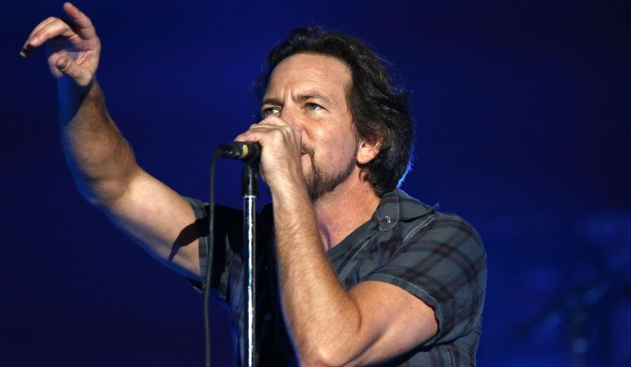 """FILE - In this Sept. 26, 2015, file photo, Eddie Vedder, of Pearl Jam, performs at the Global Citizen Festival in Central Park in New York. Rock bands Pearl Jam and Boston are canceling shows in North Carolina over the state's new law on LGBT rights. In a statement issued Monday, April 18, 2016, on the band's website, Pearl Jam called the law """"a despicable piece of legislation that encourages discrimination against an entire group of American citizens."""" (Photo by Greg Allen/Invision/AP, File)"""