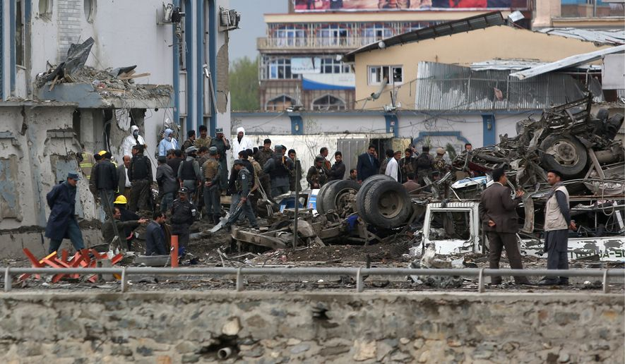 Afghan security forces inspect the site of a Taliban-claimed deadly suicide attack in Kabul, Afghanistan, Tuesday that killed 28 people. (Associated Press)