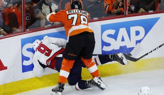 Philadelphia Flyers' Pierre-Edouard Bellemare (78) collides with Washington Capitals' Dmitry Orlov (9) during the third period of Game 3 in the first round of the NHL Stanley Cup hockey playoffs, Monday, April 18, 2016, in Philadelphia. Washington won 6-1. (AP Photo/Matt Slocum)