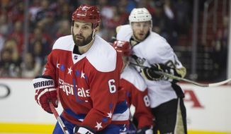 Newly acquired Washington Capitals defenseman Mike Weber stands on defense against the Pittsburgh Penguins during the first period of an NHL hockey game, on Tuesday, March 1, 2016, in Washington. (AP Photo/Evan Vucci)