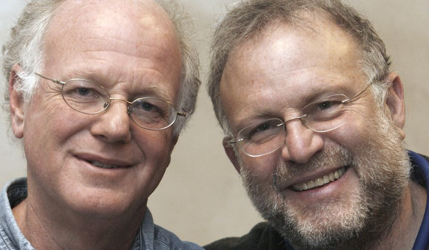 In this April 9, 2010, file photo, Vermont ice cream entrepreneurs Ben Cohen, left, and Jerry Greenfield pose for photos in Burlington, Vt. The co-founders of Ben & Jerry's were arrested Monday, April 18, 2016, at the U.S. Capitol as part of ongoing protests in Washington about the role of money in politics. (AP Photo/Toby Talbot, File)