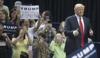 Republican presidential candidate Donald Trump gives a double thumbs up to the audience as he arrives to a campaign stop at the First Niagara Center, Monday, April 18, 2016, in Buffalo, N.Y. (AP Photo/John Minchillo)