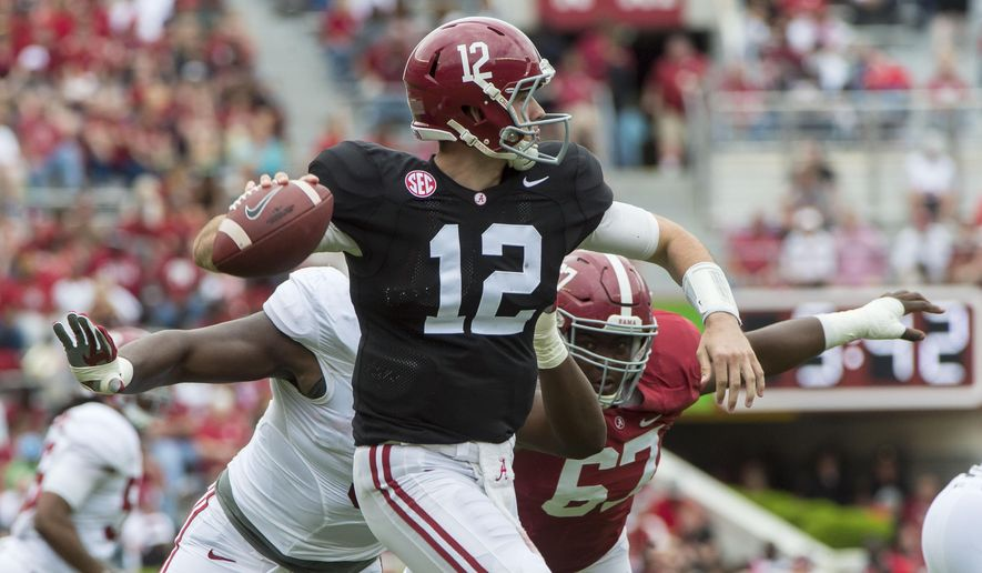 Alabama quarterback David Cornwell (12) rolls out under pressure during the second half of the NCAA college football team's A-Day spring game, Saturday, April 16, 2016, in Tuscaloosa, Ala. (Vasha Hunt/AL.com via AP)