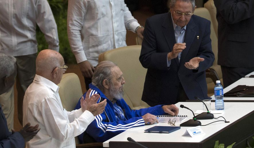 Fidel Castro is applauded by his brother, Cuba's President Raul Castro, right, and the second secretary of the Central Committee, Jose Ramon Machado Ventura, left, during the closing ceremonies for the 7th Congress of the Cuban Communist Party in Havana, Cuba, Tuesday, April 19, 2016. Fidel Castro formally stepped down in 2008 after suffering gastrointestinal ailments and public appearances have been increasingly unusual in recent years. (Ismael Francisco/Cubadebate via AP)