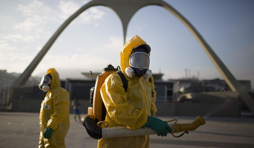 FILE - In this Tuesday, Jan. 26, 2016 file photo, a health workers stands in the Sambadrome spraying insecticide to combat the Aedes aegypti mosquito that transmits the Zika virus in Rio de Janeiro, Brazil. In the 1940s and 1950s, Brazilian authorities made such a ferocious assault on Aedes aegypti that the mosquito, that it was eradicated from Latin America's largest country by 1958. But eradication experts say there is little chance that Brazil can come anywhere near stamping out the pest like it did a half century ago. (AP Photo/Leo Correa, File)