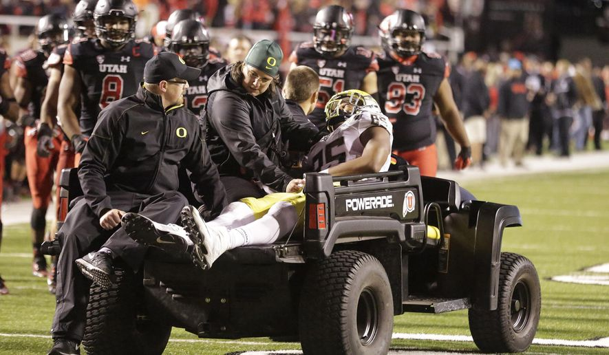 FILE - In this Saturday, Nov. 8, 2014 file photo, Oregon tight end Pharaoh Brown (85) is taken from the field after being injured in the fourth quarter during an NCAA college football game against Utah in Salt Lake City. Oregon tight end Pharaoh Brown stepped on the foot of a teammate in a goal-line play at Utah in November, 2014. Propelled forward, he came down awkwardly and his knee gave way. Three surgeries and months of rehab later, Brown is currently in the process now of what once looked like one of the most unlikely of comebacks, Tuesday, April 19, 2016. (AP Photo/Rick Bowmer, File)