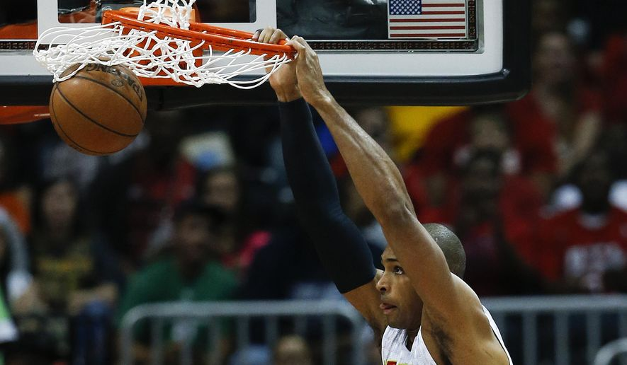 Atlanta Hawks center Al Horford (15) scores in the first half of an NBA playoff basketball game against the Boston Celtics Tuesday, April 19, 2016, in Atlanta (AP Photo/John Bazemore)