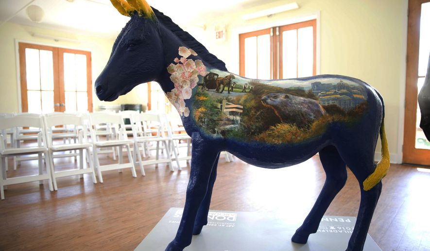 An example of one of dozens of fiberglass donkeys that will be positioned around the city ahead of the Democratic National Convention is shown, Tuesday, April 19, 2016, in Philadelphia. Fifty-seven of the painted donkeys, representing each U.S. state, territory, Washington, D.C., and Democrats Abroad will be displayed from July 1 to Sept. 5 throughout Center City, where most convention events outside the Wells Fargo Center are to take place. Local artists will paint them with iconic images from each location. (AP Photo/Matt Rourke)