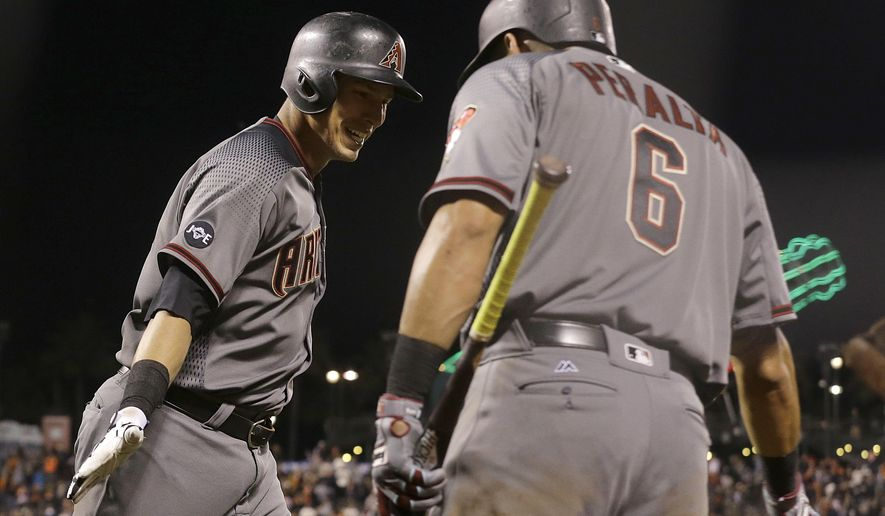 Arizona Diamondbacks' Jake Lamb, left, celebrates with David Peralta after hitting a solo home run against the San Francisco Giants during the ninth inning of a baseball game in San Francisco, Monday, April 18, 2016. (AP Photo/Jeff Chiu)