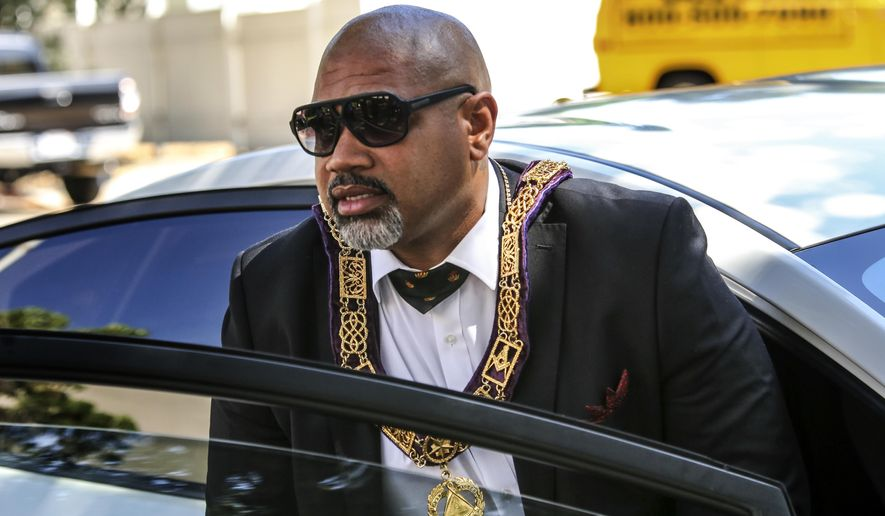 "In this June 30, 2015 photo, David Henry, accused of operating a phony police department, leaves Superior Court in San Fernando, Calif. Henry, the  ""grandmaster"" of the Masonic Fraternal Police, died of a pulmonary embolism Monday, April 18, 2016, hours after appearing in court. Earlier in the day a judge dismissed charges against Brandon Kiel, a former staffer with the California Department of Justice whom authorities said had impersonated a police officer and misused his government-issued ID. A third defendant, Tonette Hayes, still faces charges.   (Irfan Khan/Los Angeles Times via AP)  NO FORNS; NO SALES; MAGS OUT; ORANGE COUNTY REGISTER OUT; LOS ANGELES DAILY NEWS OUT; INLAND VALLEY DAILY BULLETIN OUT; MANDATORY CREDIT, TV OUT"