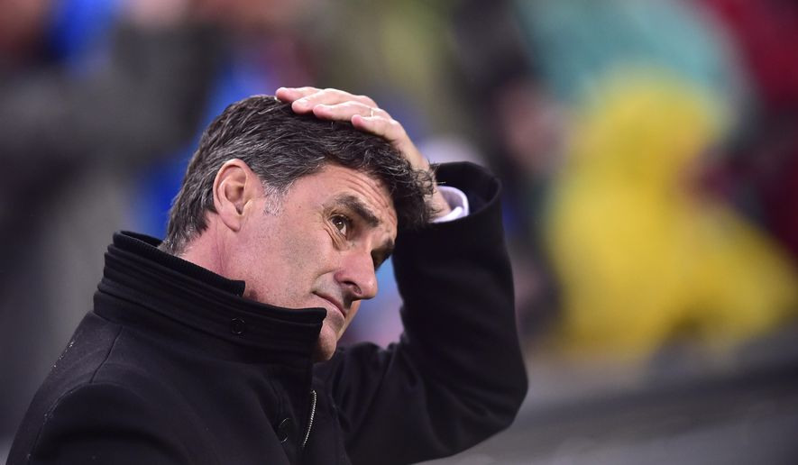 FILE - In this Feb.25, 2016 file photo, Olympique de Marseille's head coach Michel, gestures during the Europa League, round of 32, second leg soccer match, between Athletic Bilbao and Olympique de Marseille, at San Mames stadium, in Bilbao, northern Spain. Michel has been sacked Tuesday April 19, 2016 after less than a year in charge of the French league club and will be replaced by deputy coach Franck Passi until the end of the season. (AP Photo/Alvaro Barrientos)