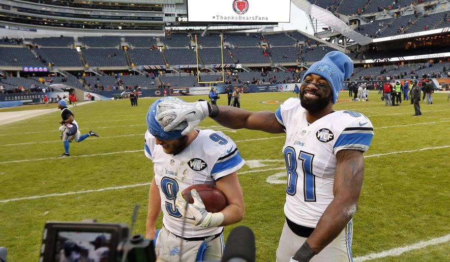 FILE - In this Jan. 3, 2016, file photo, Detroit Lions wide receiver Calvin Johnson (81) clowns around with quarterback Matthew Stafford (9) as they walk off the field after an NFL football game against the Chicago Bears in Chicago. The Lions have kicked off their first series of offseason workouts on Tuesday, April 19, 2016, under first-year general manager Bob Quinn and without Johnson, who Stafford thought might be playing his last game on Jan. 3 at Chicago. (AP Photo/Charles Rex Arbogast, File0