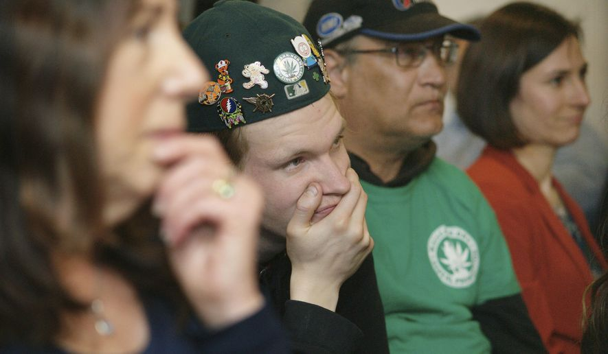 A crowd listens to speakers at a public hearing Tuesday, April 19, 2016, in Augusta, Maine. Speakers describe how marijuana helped them recover from their addiction to opioid drugs and illegal narcotics like heroin. More than 60 people attended the hearing held by the state Department of Health and Human Services. (AP Photo/Tom Bell)