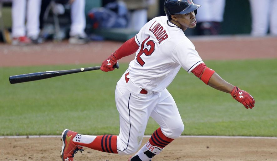 Cleveland Indians' Francisco Lindor watches his ball after hitting a double off Seattle Mariners starting pitcher Wade Miley in the third inning of a baseball game, Tuesday, April 19, 2016, in Cleveland. (AP Photo/Tony Dejak)