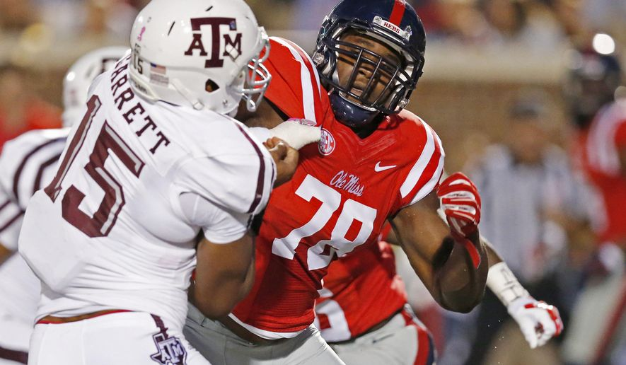 FILE - In this Oct. 24, 2015, file photo, Texas A&M defensive lineman Myles Garrett (15) is blocked by Mississippi offensive lineman Laremy Tunsil (78) during the first half of their NCAA college football game in Oxford, Miss. Tunsil is one of the top offensive players available in the NFL Draft, which starts April 28 in Chicago. (AP Photo/Rogelio V. Solis, File)