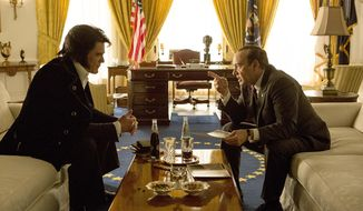 """In this image released by the Tribeca Film Festival, Michael Shannon portrays Elvis Presley, left, and Kevin Spacey portrays President Richard Nixon in a scene from """"Elvis & Nixon,"""" which will be shows at the Tribeca Film Festival, beginning Wednesday, April 13. (Steve Dietl/Bleecker Street via AP)"""