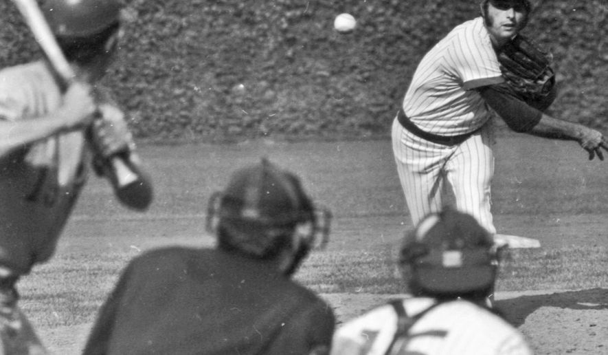 FILE - In this Sept. 20, 1972, file photo, Chicago Cubs pitcher Milt Pappas throws against the Montreal Expos to earn his 200th career win in a baseball game in Chicago. Pappas, who won 209 games during his 17-year career with the Baltimore Orioles, Cincinnati Reds, Atlanta Braves and Chicago Cubs died Tuesday morning, April 19, 2016, of natural causes at his home in the northern Illinois community of Beecher, his widow, Judi Pappas said. He was 76. (AP Photo/Fred Jewell, File)