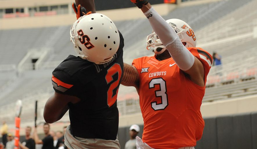 Oklahoma State black team corner back Darius Curry (2) deflects a goal line pass intended for orange team wide receiver Marcell Ateman during a spring NCAA college football game in Stillwater, Okla., Saturday, April 16, 2016. The Black team defeated  the Orange 20-7. (AP Photo/Brody Schmidt)