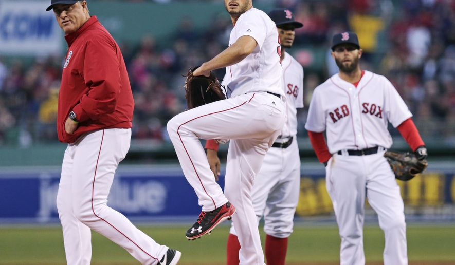 Boston Red Sox manager John Farrell, left, watches as starting pitcher Joe Kelly throws, after suffering an apparent injury, during the first inning of a baseball game against the Tampa Bay Rays in Boston, Tuesday, April 19, 2016. (AP Photo/Charles Krupa)