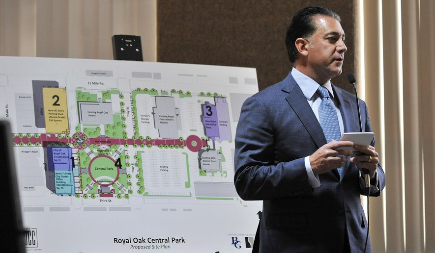 Ron Boji of the Boji Group gives a presentation about the Royal Oak Central Park plan at the Royal Oak city commissioners meeting on Monday, April 18, 2016.  Plans are in the works in the Detroit suburb  for a $100 million project that would include a new city hall, commercial offices, parking structure, police station and park. (Robin Buckson/Detroit News via AP)  DETROIT FREE PRESS OUT; HUFFINGTON POST OUT; MANDATORY CREDIT