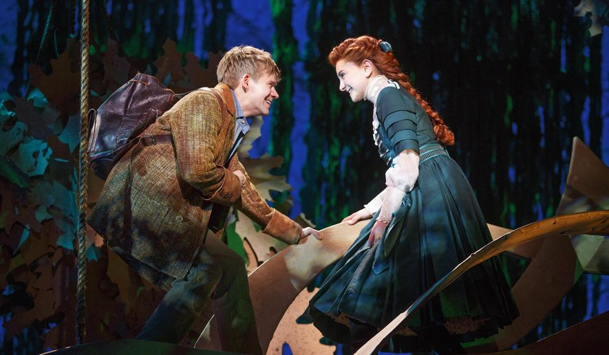"""This image released by Matt Ross Public Relations shows Andrew Keenan-Bolger, left, and Sarah Charles Lewis during a performance of """"Tuck Everlasting,"""" opening on Broadway on April 26. (Joan Marcus/Matt Ross Public Relations via AP)"""