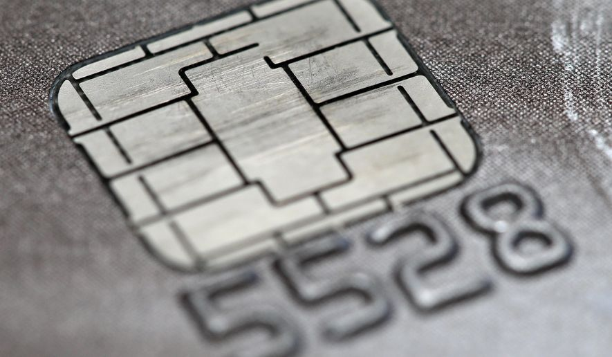 FILE -This June 10, 2015 photo shows a chip credit card in Philadelphia.   Visa says its improving its smart chip-embedded cards, which have been the source of grumbling from businesses and customers forced to wait for transactions to go through. The company said Tuesday, April 19, 2016 that Quick Chip for EMV will let customers dip and remove cards, usually in two seconds or less, without waiting for purchases to be finalized. (AP Photo/Matt Rourke)
