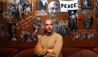 Busboys and Poets owner Andy Shallal stands behind Mayor Bowser's plan to raise the wage for restaurant wait staff, adding he hopes it will lead to living wages and do away with tipping. (Astrid Riecken/The Washington Times)