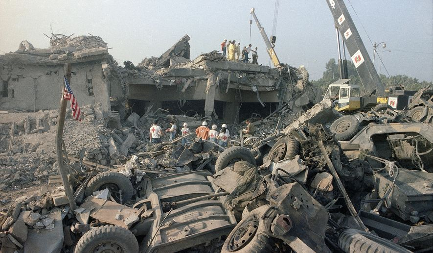 In this Oct. 23, 1983, file photo, the aftermath of the bombing of the U.S. Marines barracks in Beirut, Lebanon. The Supreme Court upheld a judgment allowing families of victims of Iranian-sponsored terrorism to collect nearly $2 billion. The court on Wednesday, April 20, 2016, ruled 6-2 in favor of relatives of the 241 Marines who died in a 1983 terrorist attack in Beirut and victims of other attacks that courts have linked to Iran.(AP Photo/Jim Bourdier, File)
