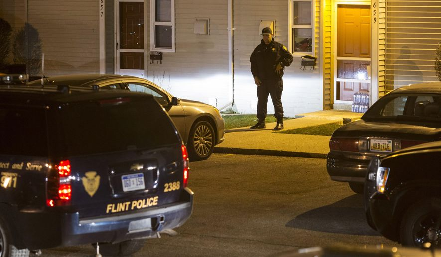 Police respond to a fatal shooting Tuesday, April 19, 2016, in Flint, Mich. (Conor Ralph/The Flint Journal-MLive.com via AP) LOCAL TELEVISION OUT; LOCAL INTERNET OUT; MANDATORY CREDIT