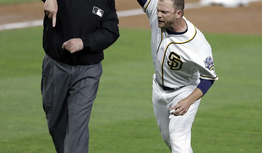 San Diego Padres manager Andy Green, right, throws his cap as he is ejected by third base umpire Brian Gorman after complaining about a call during the third inning of a baseball game against the Pittsburgh Pirates on Tuesday, April 19, 2016, in San Diego. (AP Photo/Gregory Bull)