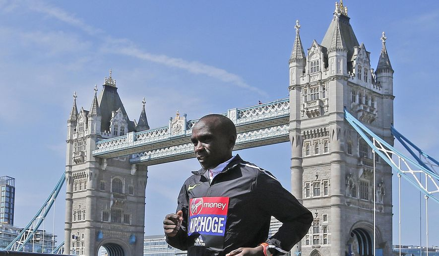 Kenya's Eliud Kipchoge poses for photographers ahead of the London marathon at the Tower Bridge in London, Wednesday, April 20, 2016. The London marathon will take place on Sunday. (AP Photo/Frank Augstein)