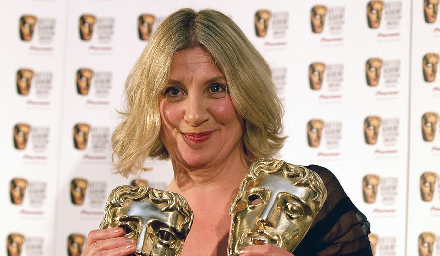 In this file photo taken in London on Sunday, May 20, 2007, British comedienne Victoria Wood holds her two BAFTA awards, one for Best Actress and one for Best Single Drama both received for Housewife 49. (AP Photo/ Max Nash, File)