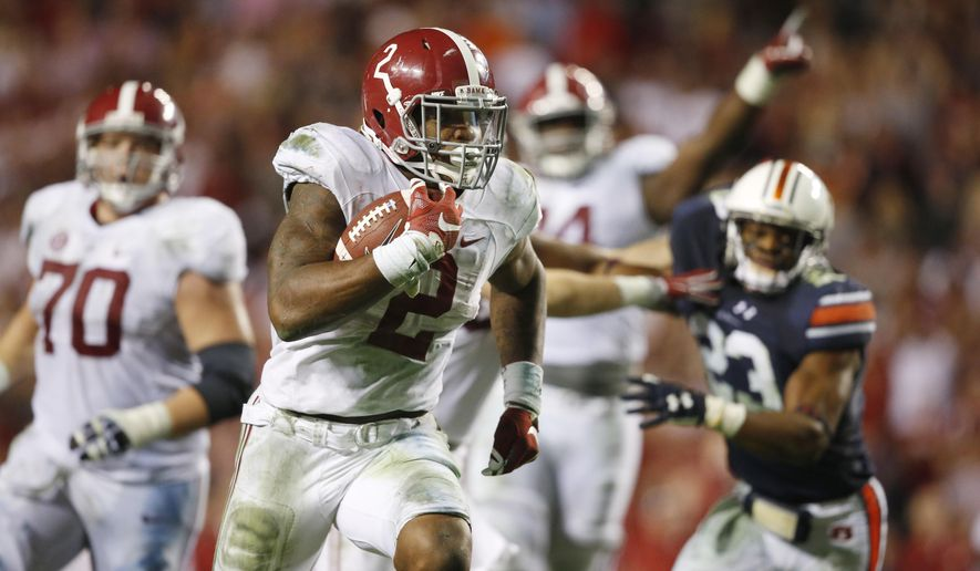 FILE - In this Nov. 28, 2015, file photo, Alabama running back Derrick Henry (2) runs for a touchdown in the second half of an NCAA college football game against Auburn in Auburn, Ala. Henry figures to be either a late first-round or a second-round pick in next week's NFL draft. He'd be the fifth running back from Alabama picked in the first two rounds since 2011.  (AP Photo/Gerald Herbert, File)