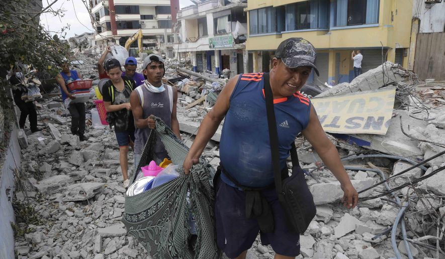 Residents recover their belongings days after an earthquake in Pedernales, Ecuador, Wednesday, April 20, 2016. Ecuadoreans began burying loved ones felled by the country's deadliest earthquake in decades, while hopes faded that more survivors will be found. (AP Photo/Dolores Ochoa)