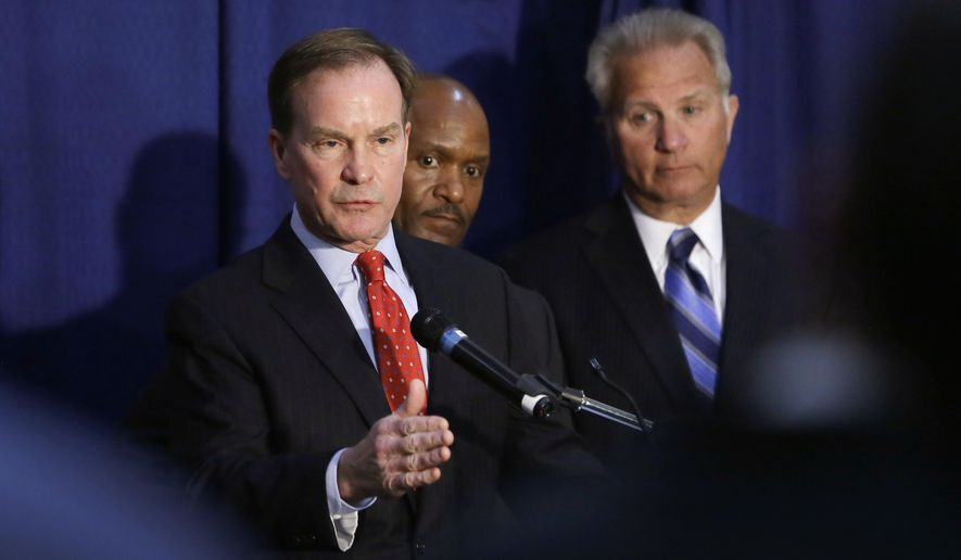 Michigan Attorney General Bill Schuette addresses the media, Wednesday, April 20, 2016 in Flint, Mich. Months after officials conceded that a series of bad decisions had caused a disaster, charges were filed against a pair of state Department of Environmental Quality employees and a local water treatment supervisor and stem from an investigation by the office of the attorney general. (AP Photo/Carlos Osorio)