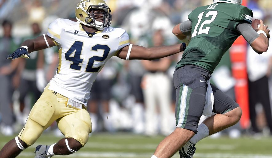 FILE - In this Sept. 12, 2015, file photo, Tulane quarterback Tanner Lee (12) runs out of the pocket as Georgia Tech defensive end KeShun Freeman (42) rushes in during the first half of an NCAA college football game in Atlanta. Freeman returns as third-year starting end for Georgia Tech's defense, but defensive coordinator Ted Roof says nobody, including Freeman, should think his job is safe after the Yellow Jackets went 3-9 last season.  (AP Photo/Mike Stewart, File)