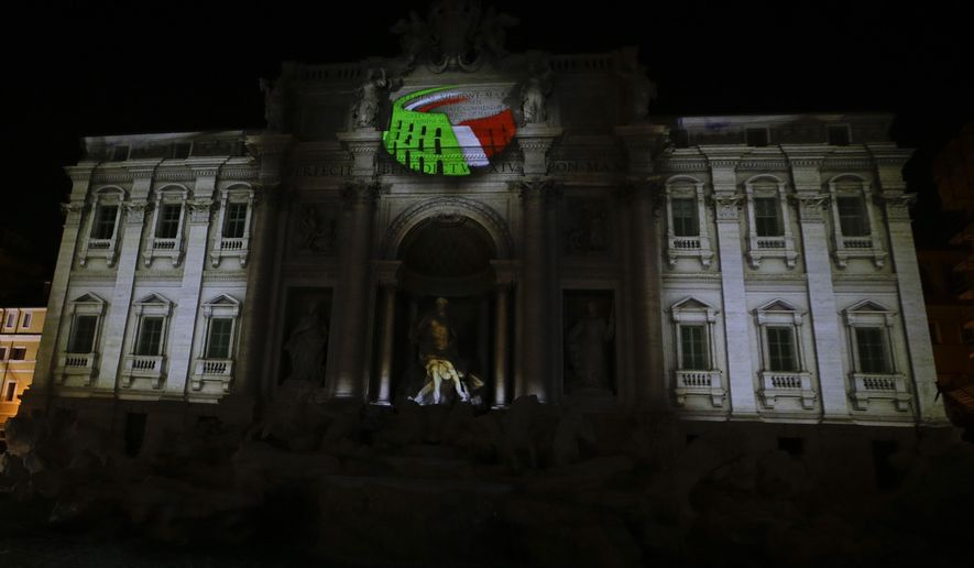 FILE -- In this file photo taken on Dec. 14, 2015, the logo for the candidacy of Rome for the 2024 Olympic games is projected on the Trevi's fountain in Rome. One of the leading candidates for next month's mayoral election, Virginia Raggi of the opposition 5-Star Movement, has come out against Rome's bid for the 2024 Olympics.. (AP Photo/Gregorio Borgia)