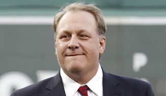 Former Boston Red Sox pitcher Curt Schilling looks on after being introduced as a new member of the Boston Red Sox Hall of Fame before a baseball game between the Red Sox and the Minnesota Twins at Fenway Park in Boston on Aug. 3, 2012. (Associated Press) **FILE**