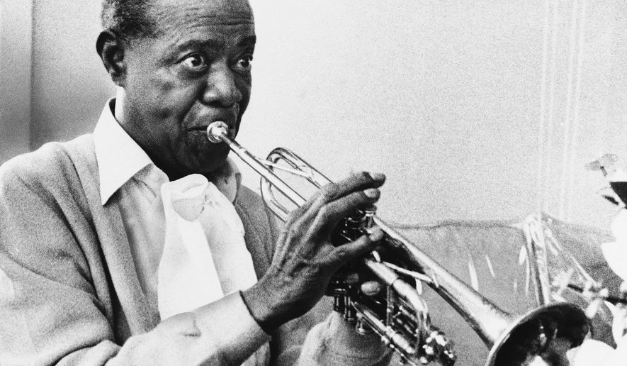 FILE - In a June 21, 1971 file photo, Louis Armstrong practices with his horn at his Corona, New York home. The Louis Armstrong House Museum announced Wednesday, April 20, 2016, that it has acquired the only known film footage of the great jazz musician in a recording studio. While many audio recordings of Armstrong's music exist there has been no video of him working in a recording studio until now. (AP Photo/Eddie Adams, File)