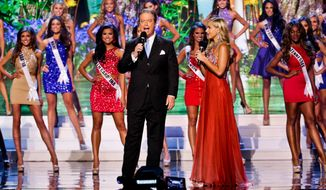 FILE - In this July 12, 2015 file photo, Miss USA co-host Todd Newton and former Miss Wisconsin USA 2009, Alex Weherley during the 2015 Miss USA pageant in Baton Rouge, La. The Miss Universe Organization said Wednesday, April 20, 2016, it will conduct an online search for a candidate to join the 51 contestants from all 50 states and the District of Columbia on the live telecast June 5 on Fox. (AP Photo/Derick E. Hingle, File)