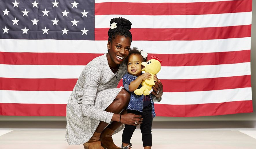 In this photo taken Nov. 18, 2015, Alysia Montano poses with her daughter, Linnea Dori. Some who follow women's track know Montano as the Flyer Flower, for the bit of colorful flora she tucks in her hair when competing. Others may remember 2014, when she decided to take advantage of her qualifying standard in the 800 meter and enter the outdoor U.S. championships while 34 weeks pregnant. The idea: To just have some fun while advocating for women to get off the couch and move around during pregnancy. The goal: Not to get lapped during the two-lap race. Montano was successful on both counts and has since proudly brought Linnea Dori to practices and events, tucking flowers into her little girl's hair as well while chatting with the media.  (Mitchell Haaseth/NBC/USOC via AP)