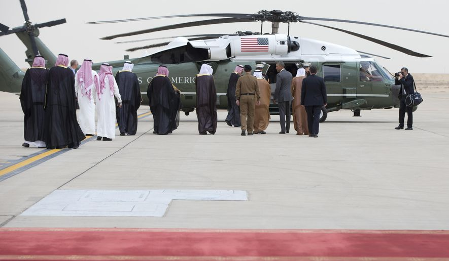 President Barack Obama walks to Marine One as he arrives on Air Force One at King Khalid International Airport in Riyadh, Saudi Arabia, Wednesday, April 20, 2016. The president begins a six day trip to strategize with his counterparts in Saudi Arabia, England and Germany on a broad range of issues with efforts to rein in the Islamic State group being the common denominator in all three stops. Among those walking with the president are Ambassador Joseph W. Westphal, U.S. Ambassador to the Kingdom of Saudi Arabia, Prince Faisal bin Bandar bin Abdulaziz Al-Saud, Governor of Riyadh, Engineer Ibrahim Al-Sultan, Mayor of Riyadh Region, Fahad Al-Saheel, Royal Protocol - Airports In-charg. (AP Photo/Carolyn Kaster)