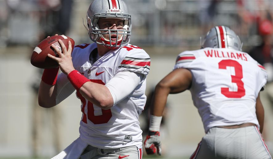 FILE - In this Saturday, April 16, 2016 file photo, Ohio State quarterback Joe Burrow plays in Ohio State's NCAA college football spring game in Columbus, Ohio. Ohio State just wrapped up its 15 spring practices with the spring game, and coach Urban Meyer and position coaches talked about the road ahead, Wednesday, April 20, 2016. (AP Photo/Jay LaPrete, File)